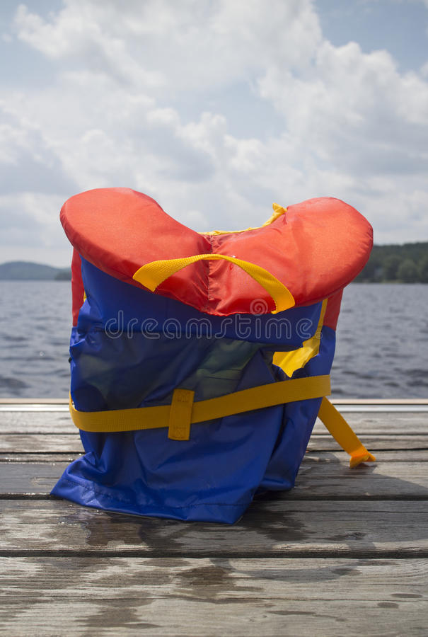 Do not leave it on the pier. Closeup of a life jacket on a pier stock images