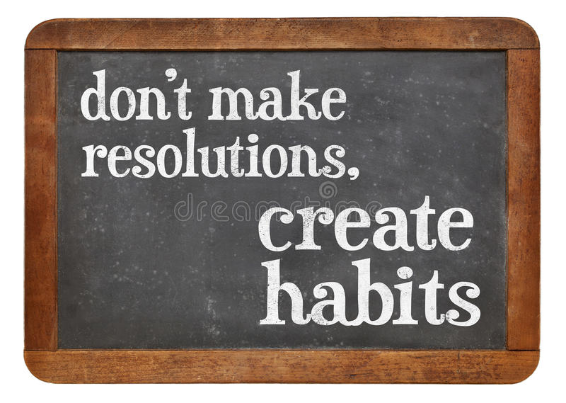 Do not make resolutions blackboard sign. Do not make resolutions, create habits - advice on a vintage blackboard stock image