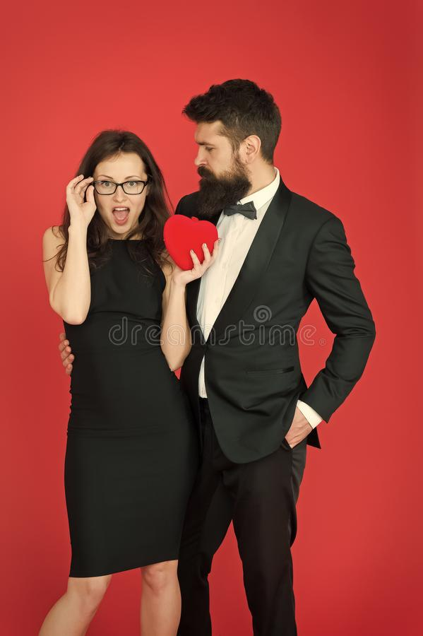 Do not play with my heart. Man with beard and woman happy celebrate anniversary. Couple in love dating anniversary. Man stock photography