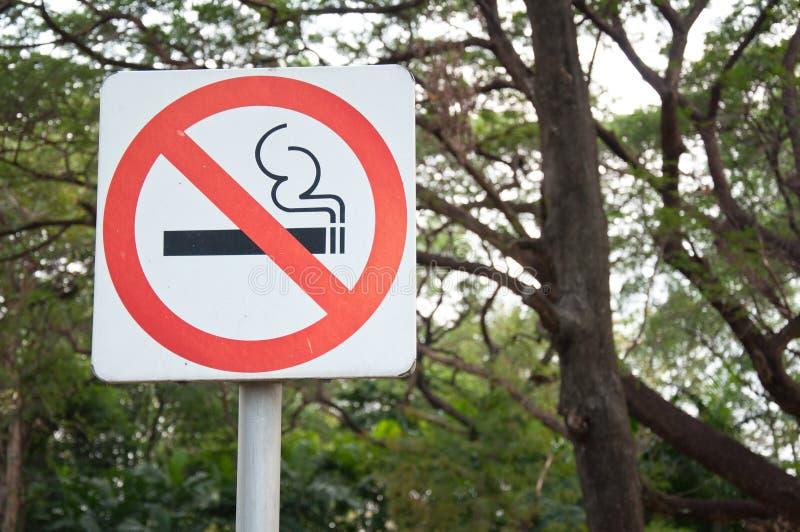 Do not smoke in the garden. Do not smoke sign in the garden stock images