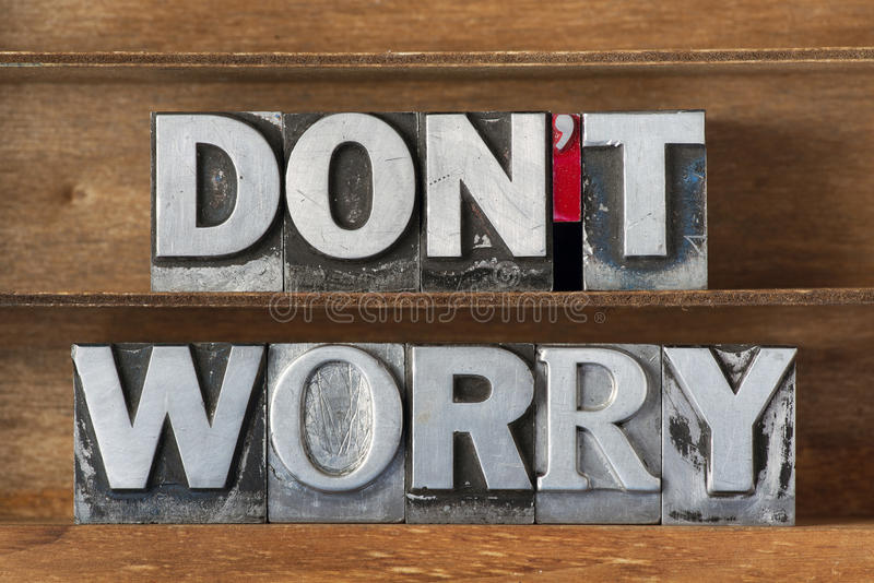 Do not worry tr. Don't worry phrase made from metallic letterpress type on wooden tray royalty free stock image