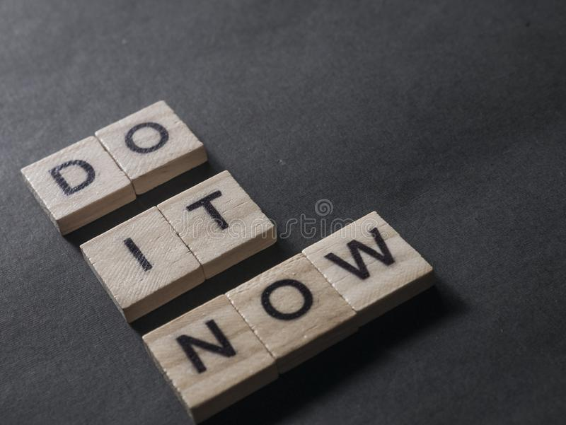 Do It Now, Motivational Inspirational Quotes. Do It Now, business motivational inspirational quotes, words typography concept action time encouragement plan goal royalty free stock photo