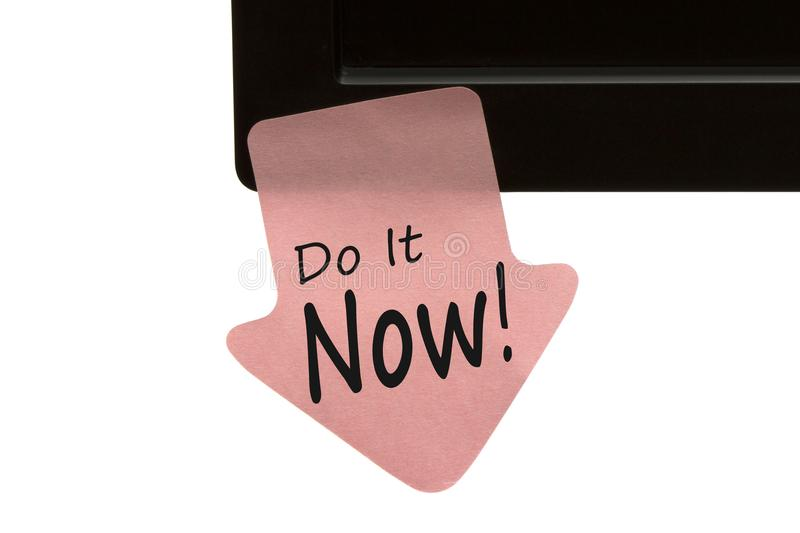 Do It Now written on note concept. Do It Now! written on reminder sticky note on monitor isolated on white background. Business Concept royalty free stock photography