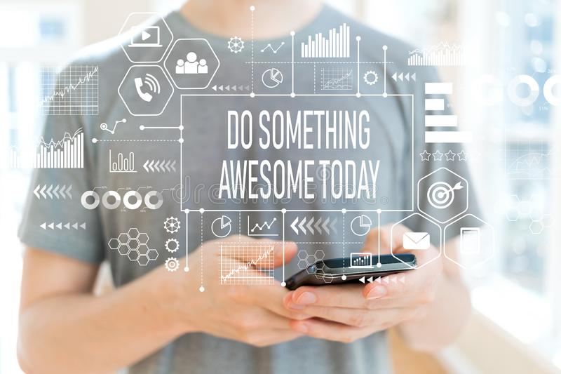 Do something awesome today with man using a smartphone royalty free stock images