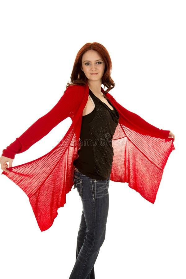 Do suporte vermelho do cabelo da mulher a camiseta vermelha guarda para fora fotografia de stock