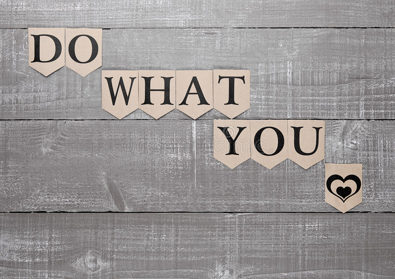Do what you love sign heart symbol on wood board stock image