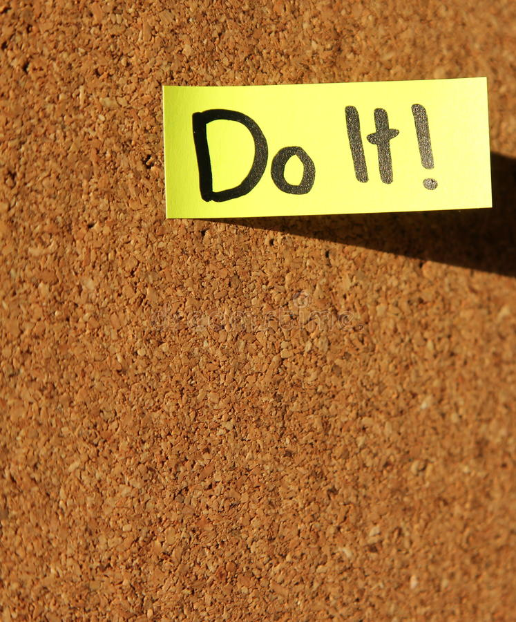 Do It!. Yellow sticky note with text - do it royalty free stock photography