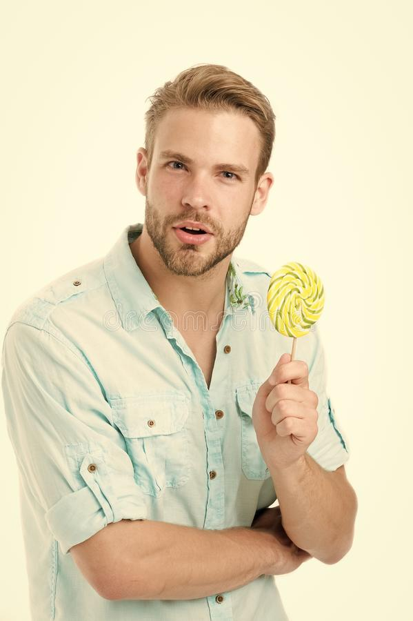 Do you know. Impressing fact harmful sugar nutrition. Man handsome bearded guy holds lollipop candy. Man with lollipop. Looks puzzled. Healthy nutrition and stock image