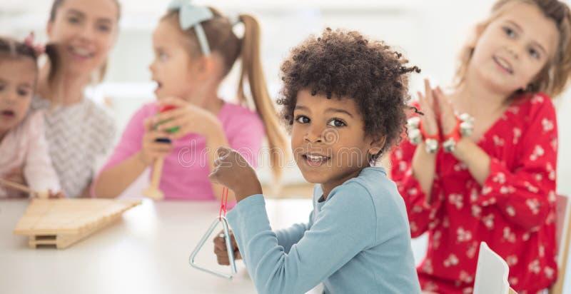 Do you like music. ? Children in preschool stock images