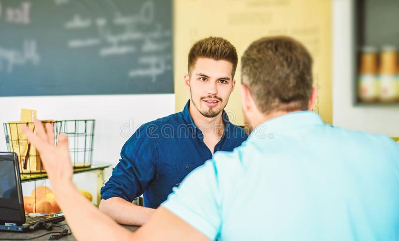 Do you need problems. Man client emotional arguing with staff person. Unsatisfied visitor angry about service. Man. Yelling at barista guy stand on background royalty free stock photo