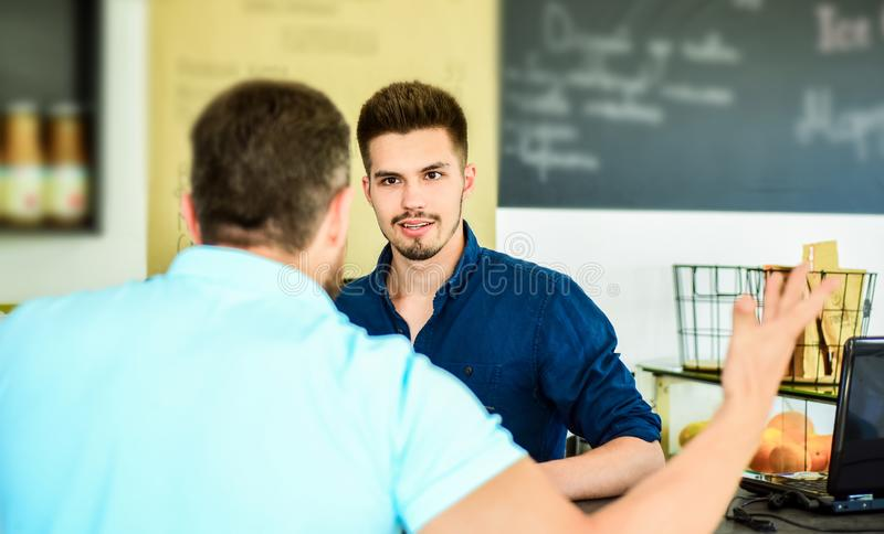 Do you need problems. Man client emotional arguing with staff person. Unsatisfied visitor angry about service. Man. Yelling at barista guy stand on background royalty free stock images