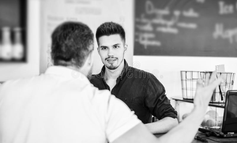 Do you need problems. Man client emotional arguing with staff person. Unsatisfied visitor angry about service. Man. Yelling at barista guy stand on background stock photography