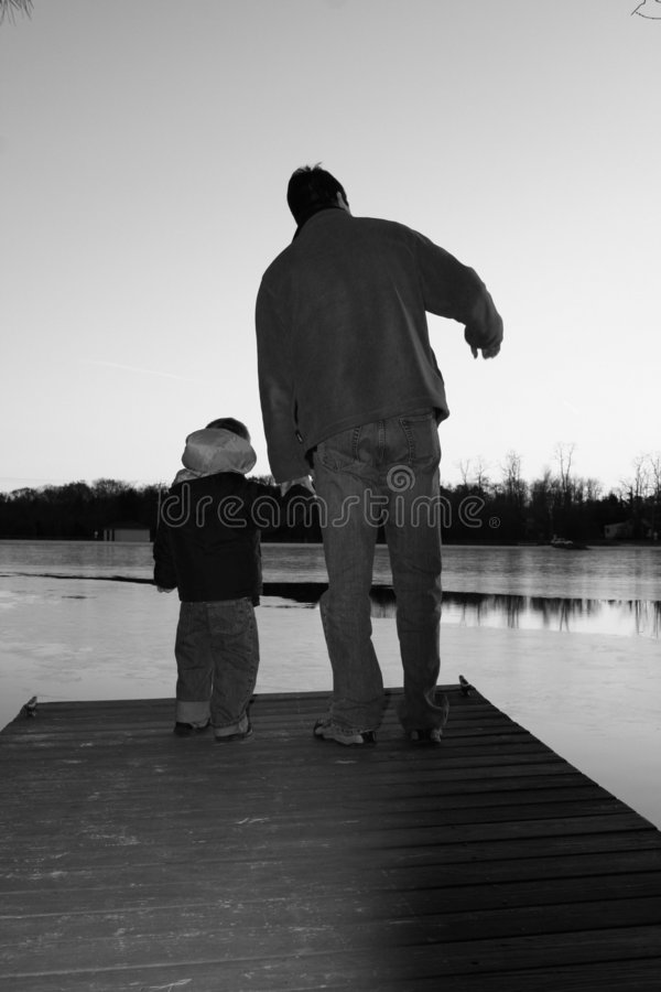 Father and Son on Lakeside Dock - Black and White