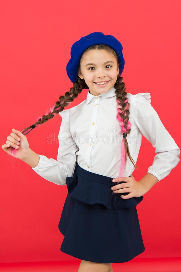 Do you speak french. School fashion concept. Schoolgirl wear formal school uniform and beret hat. Child beautiful girl stock images