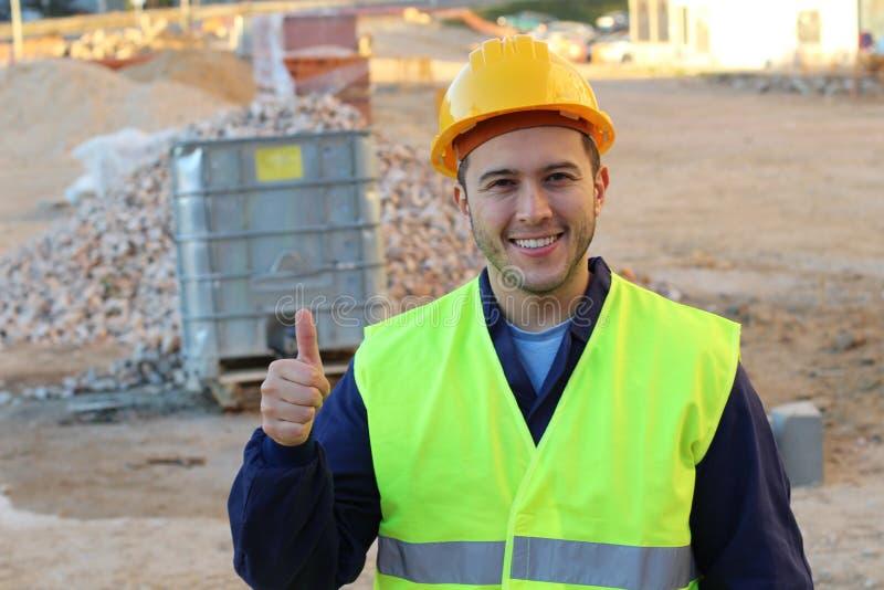 Doação étnica do trabalhador da construção polegares acima imagens de stock royalty free