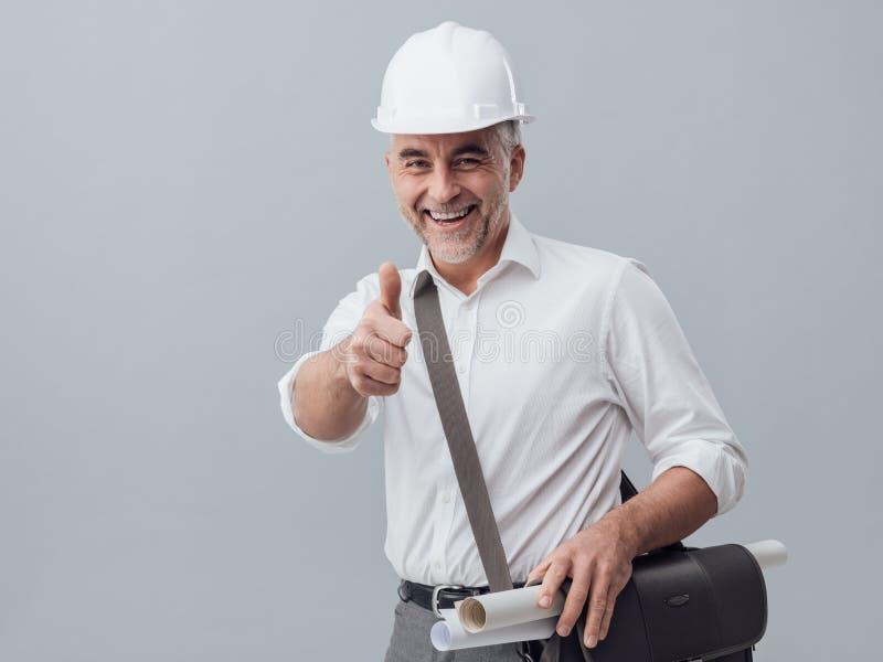 Doação do coordenador de construção polegares acima imagem de stock royalty free