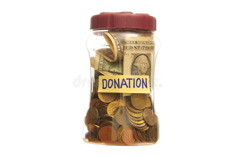 Doação em um frasco fotografia de stock royalty free