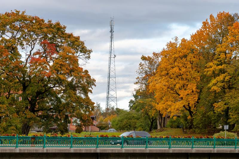 Dobele, Latvia. Autumn city landscape with bridges and colorful maples.  stock photo