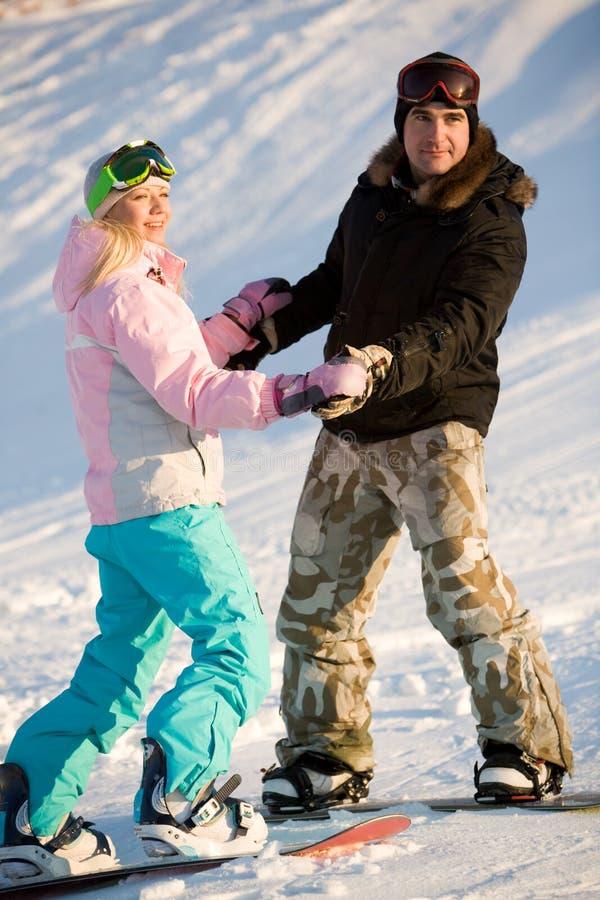 dobiera się snowboarders zdjęcie royalty free