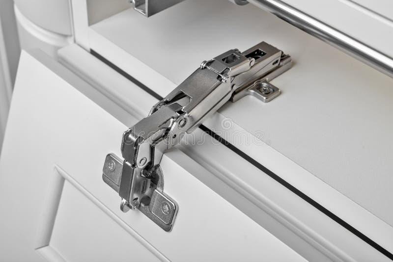 Dobradiças do metal para um armário Fim acima fotografia de stock