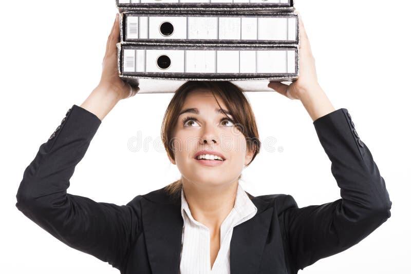 Dobradores carying da mulher de negócio imagem de stock