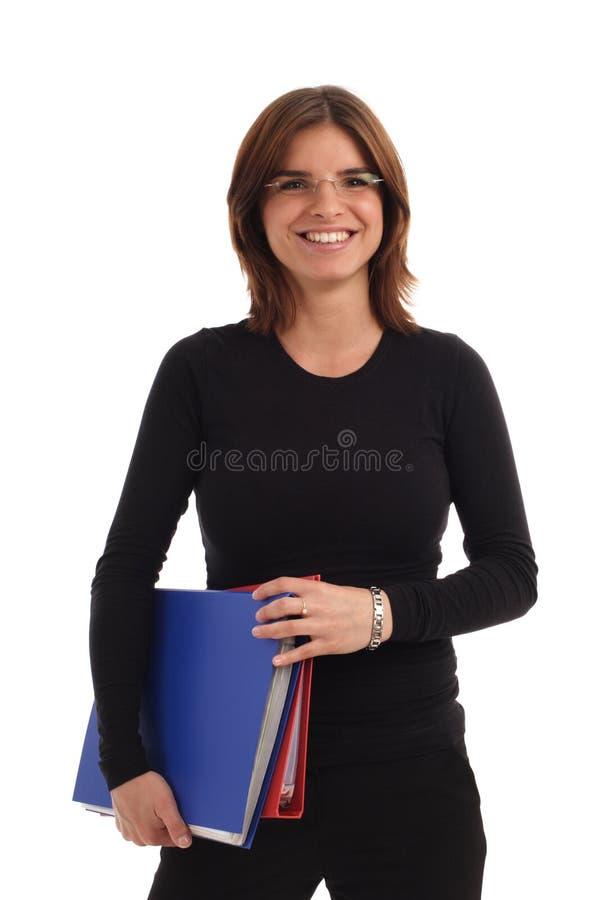 Dobradores da terra arrendada da mulher nova foto de stock
