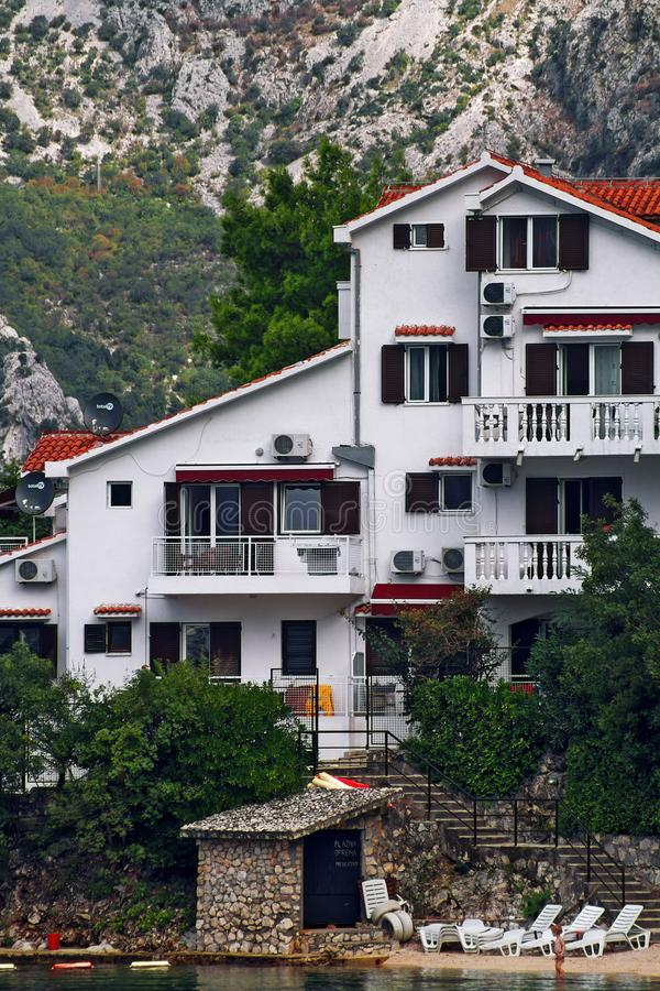 DOBROTA, MONTENEGRO, September 21, 2016: view of the villa with its own beach in the mountains royalty free stock photo