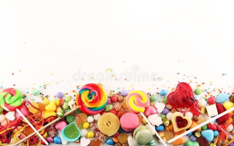 Doces com geleia e açúcar disposição colorida de childs diferentes fotografia de stock