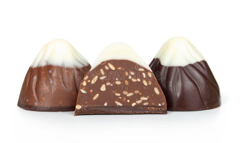 Doces de chocolate isolados imagens de stock