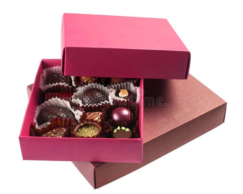 Doces de chocolate na caixa imagem de stock
