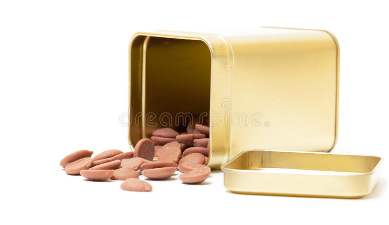 Doces de chocolate na lata de estanho imagem de stock royalty free