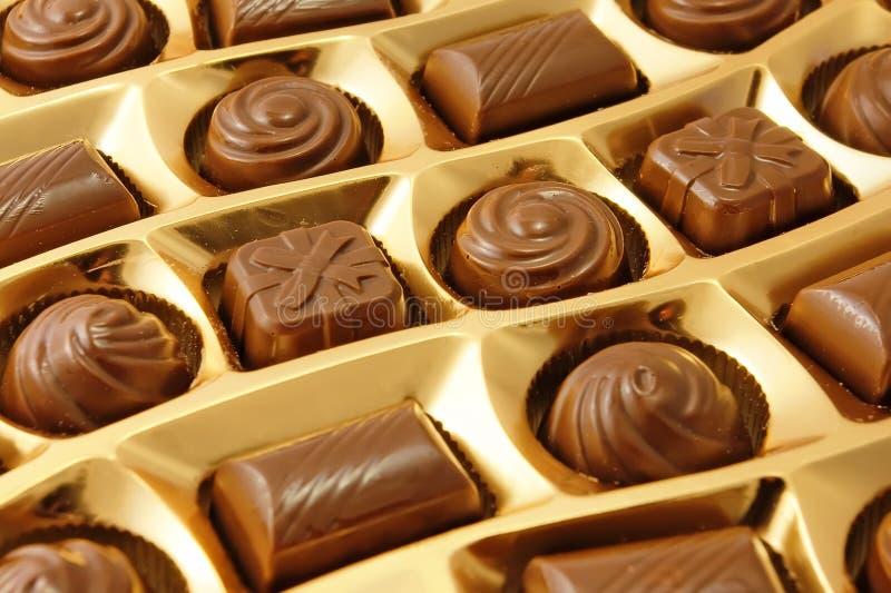 Doces do chocolate em uma caixa foto de stock royalty free
