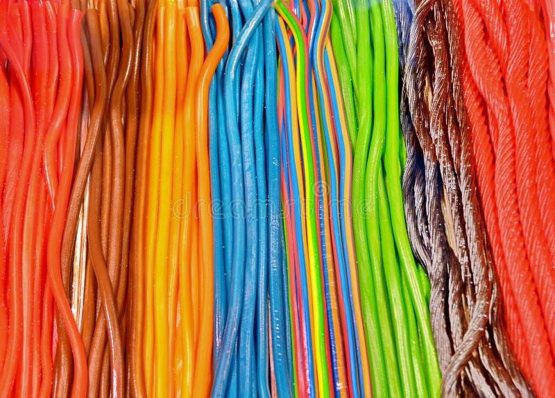 Doces e doces de açúcar coloridos imagens de stock