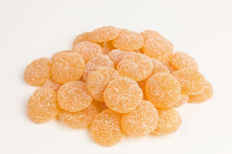 Doces gomosos da tangerina foto de stock