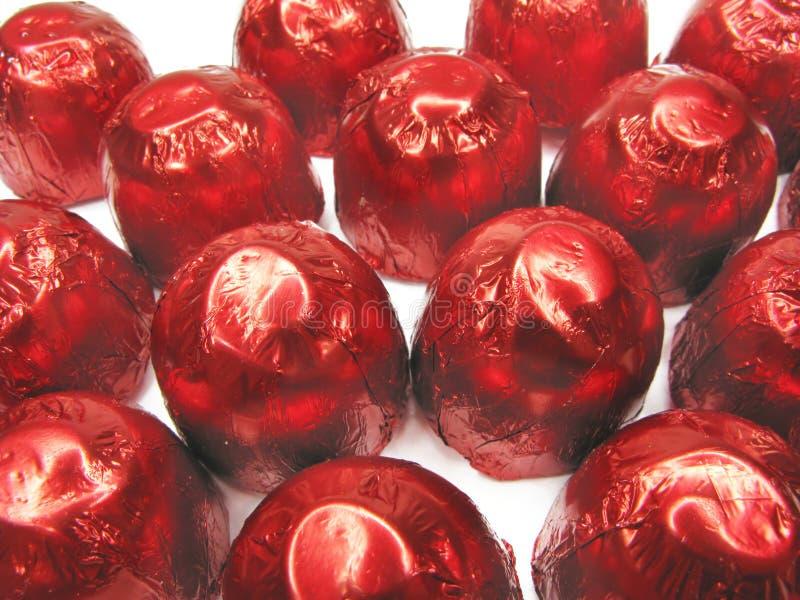Download Doces No Envolvimento Vermelho Foto de Stock - Imagem de chocolate, doces: 12804894