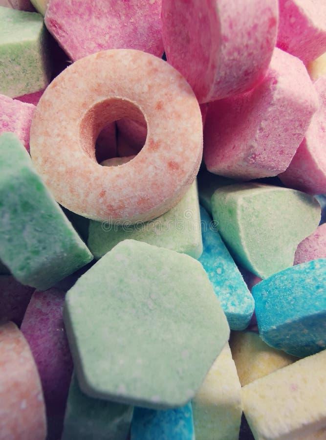 Doces pulverizados, fundo dos doces de açúcar - grupo de sobremesa colorida fotografia de stock