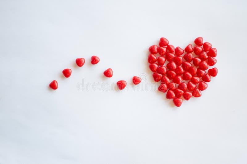 Doces vermelhos do coração para Valentim com espaço da cópia fotografia de stock royalty free