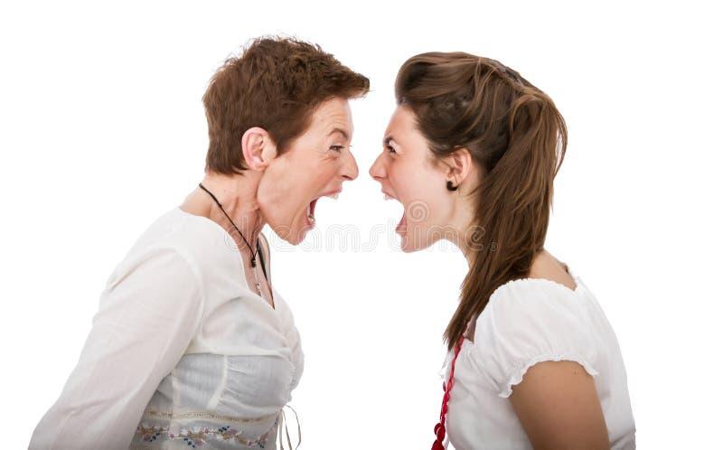 Dochter en moeder boos ogenblik royalty-vrije stock foto's