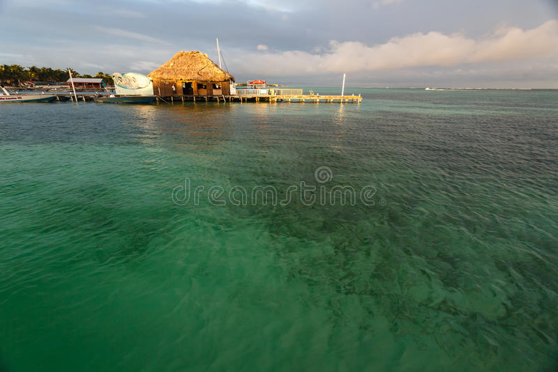 Dock in Ambergris Caye off the coast of Belize royalty free stock image