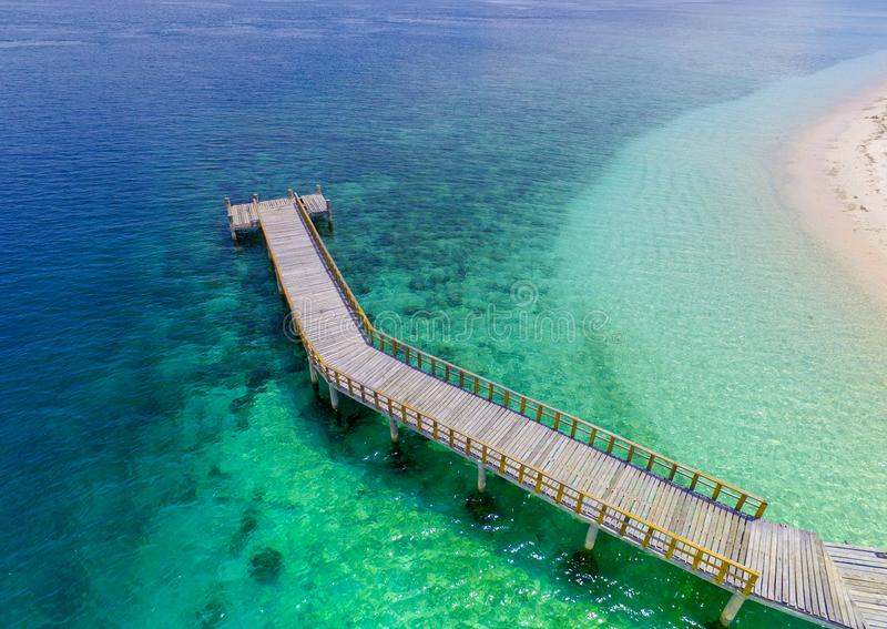 Dock beautiful Turquoise lagoon with a coral reef and white beach stock image