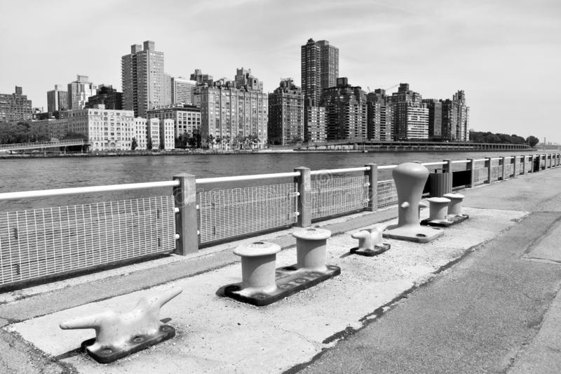 Dock Cleats on Roosevelt Island. Plus the Manhattan Skyline in Black and White stock images