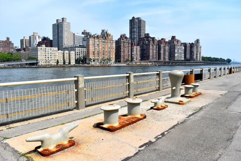 Dock Cleats on Roosevelt Island. Rusty Dock Cleats on Roosevelt Island plus the Manhattan Skyline in Color royalty free stock photos