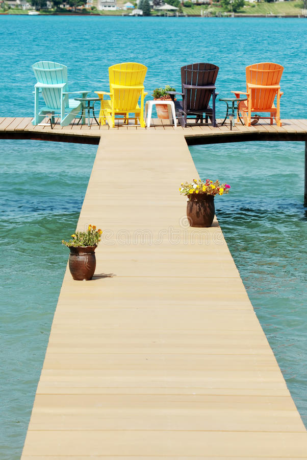 Download Dock With Colorful Adirondack Chairs Stock Photo   Image Of  Orange, Relaxing: 15990588