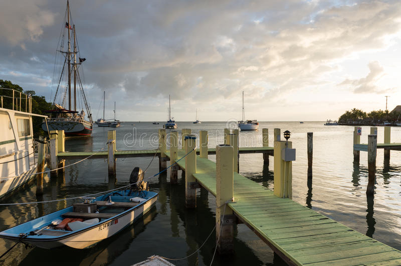 Dock in Key Largo. KEY LARGO, FL - CIRCA 2012: View of typical dock with boath in Key Largo circa 2012. The Florida Keys are a very popular tourist destination stock photos