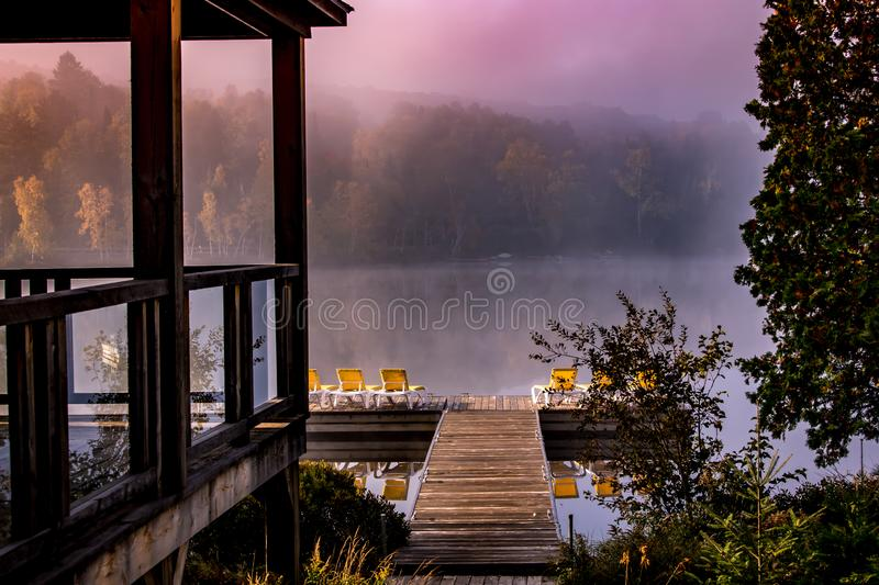 Dock on Lac Superieur, Mont-tremblant, Quebec, Canada. View of a boat dock the Lac Superieur, misty morning with fog, in Laurentides, Mont-tremblant, Quebec stock photo