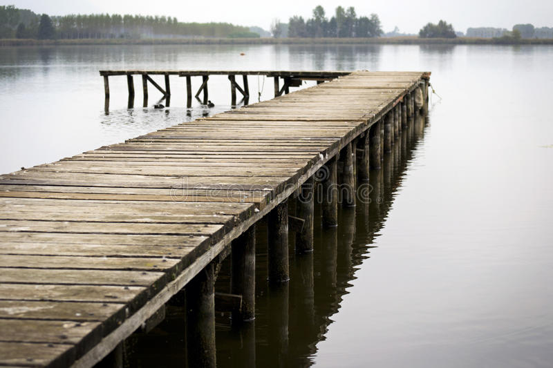 Dock on a lake royalty free stock images