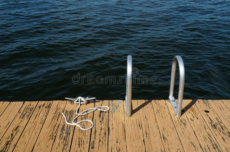 Dock on a lake with a ladder stock image