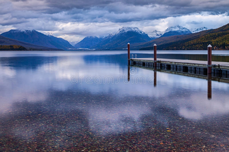 The dock on Lake MacDonald in Glacier National Park. stock photos