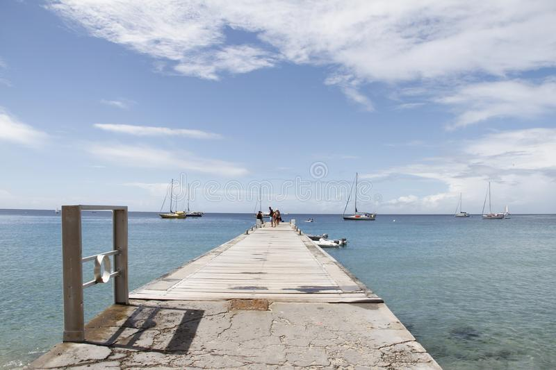 Dock at Les Anses d`Arlet, Grand Anse, Martinique French West Indies, France royalty free stock photos