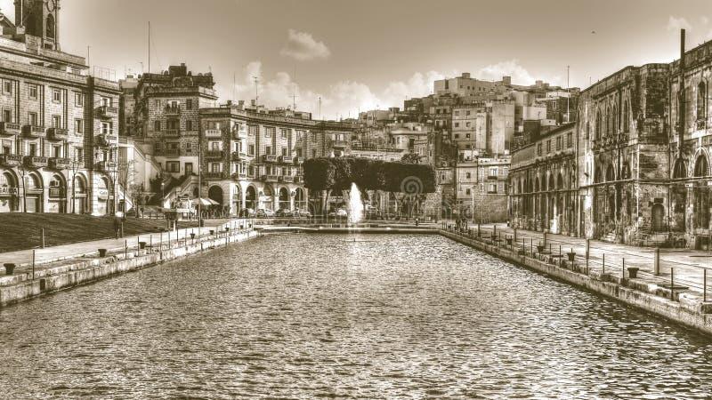 Dock No. 1, Cospicua, Malta sepia tone HDR photography. Malta - 13 Jan 2016: Dock No. 1, Cospicua, Malta sepia tone HDR photography stock image